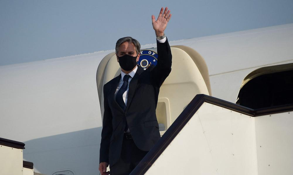 The US secretary of state, Antony Blinken, boards an aircraft as he departs Doha, Qatar, to travel to Germany.