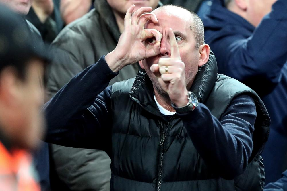 January 13: A Manchester United fan taunts the Tottenham fans by gesturing the scoreline.