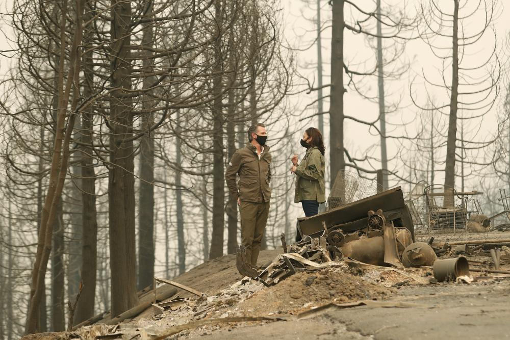California Governor Gavin Newsom and Democratic vice presidential candidate Kamala Harris assess wildfire damage in Auberry, California.