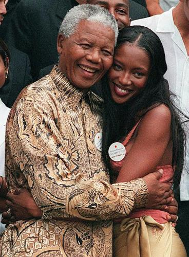 South African President Nelson Mandela with British supermodel Naomi Campbell