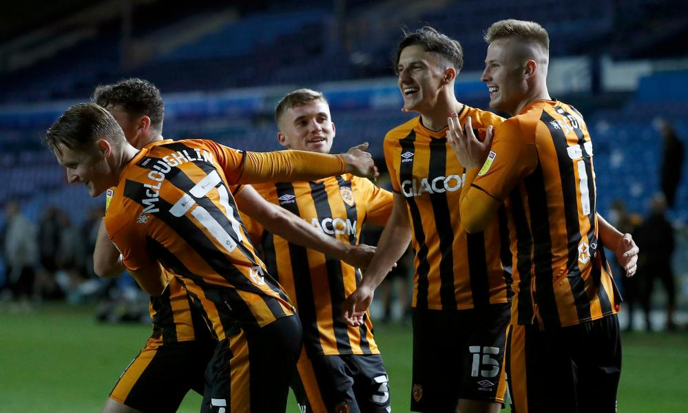 Alfie Jones of Hull City celebrates with teammates after scoreing the winning penalty.