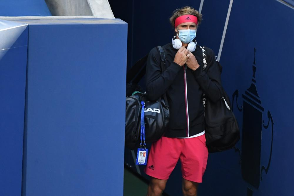 Germany's Alexander Zverev walks onto the court for his match against Adrian Mannarino of France.