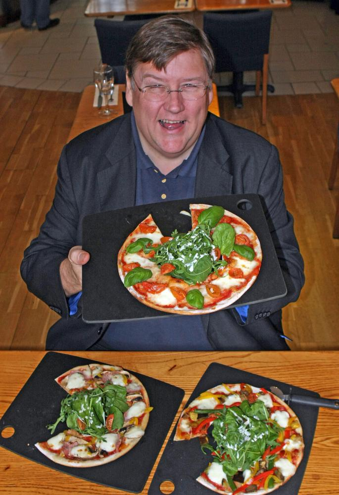 Charles Campion sampling pizzas as part of his work as Evening Standard food critic.