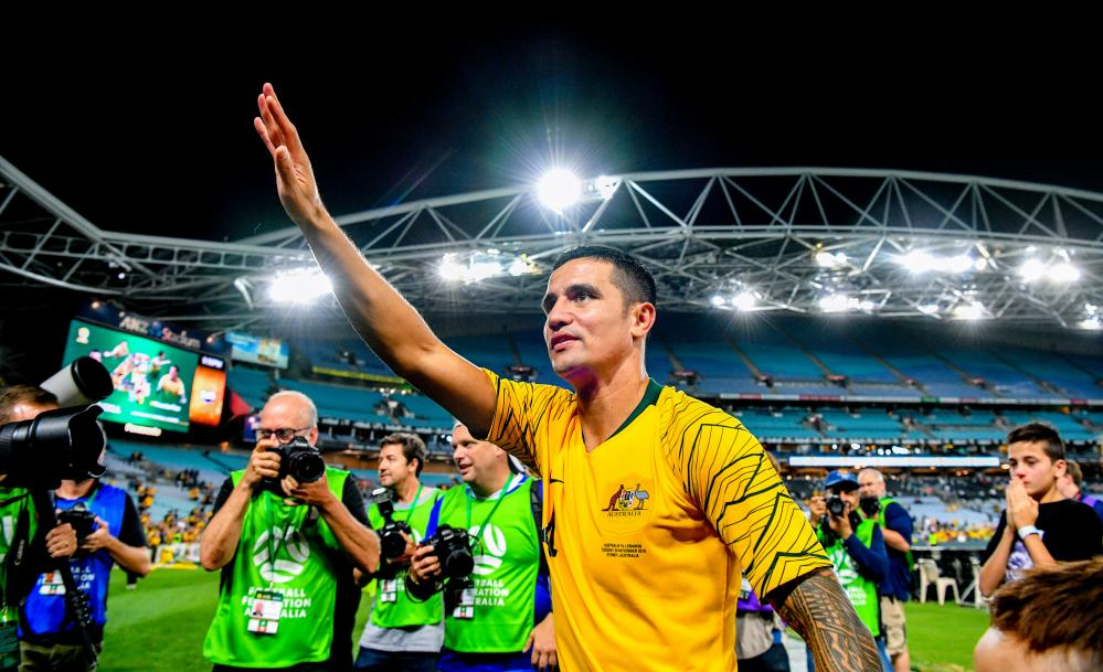 Tim Cahill greets fans after the game.