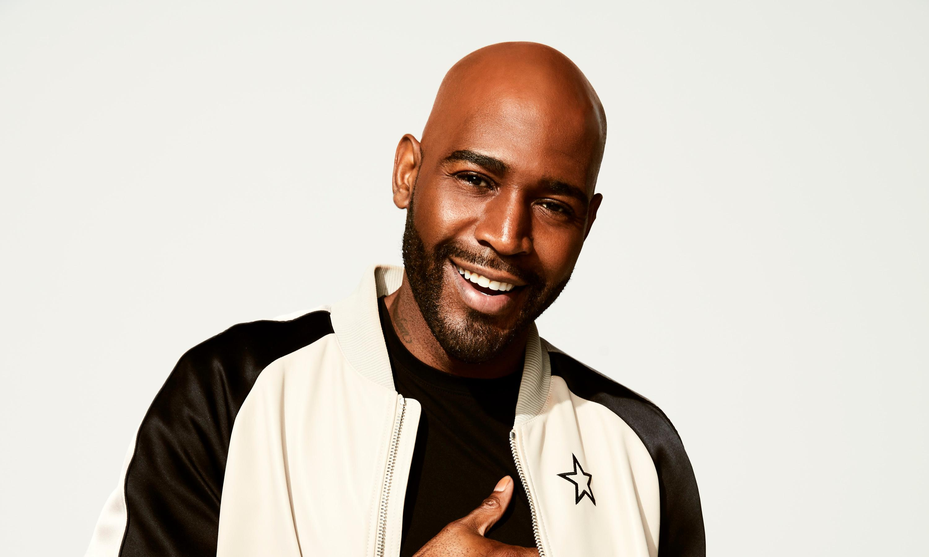 Queer Eye's Karamo Brown under fire after praising Sean Spicer as 'sweet guy'