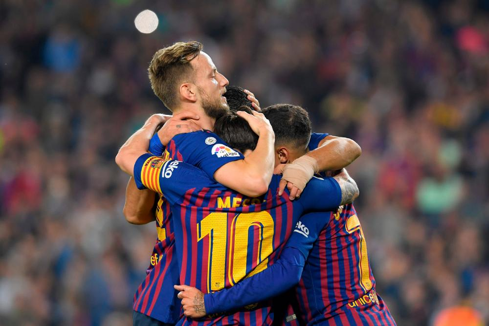 Ivan Rakitic takes the acclaim of his teammates after another searing strike.