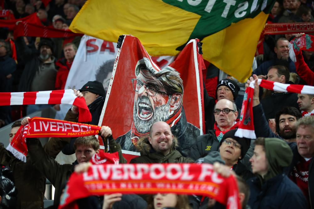 Fans of Liverpool show their support before kick-off.