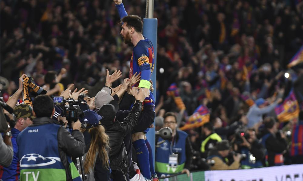 Lionel Messi celebrates at full-time.