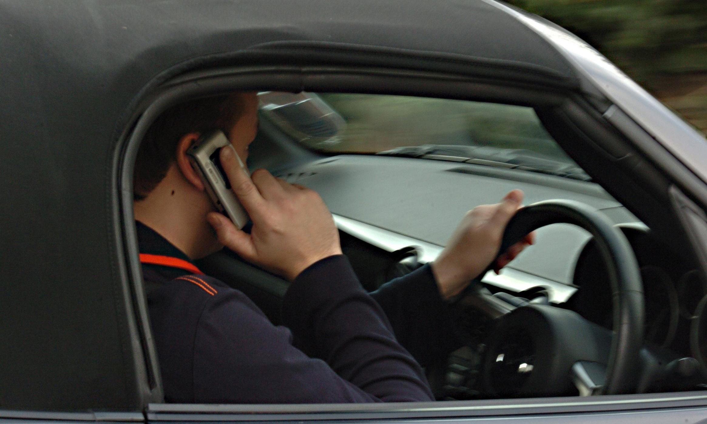 Ban hands-free phones in cars after rise in road deaths, MPs suggest