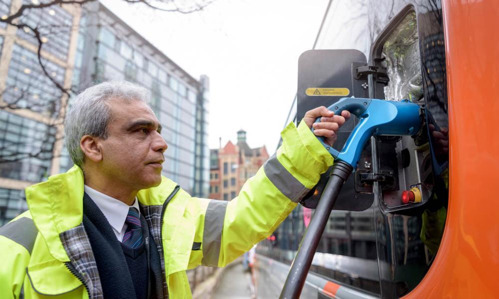 Man recharging public transportation vehicle