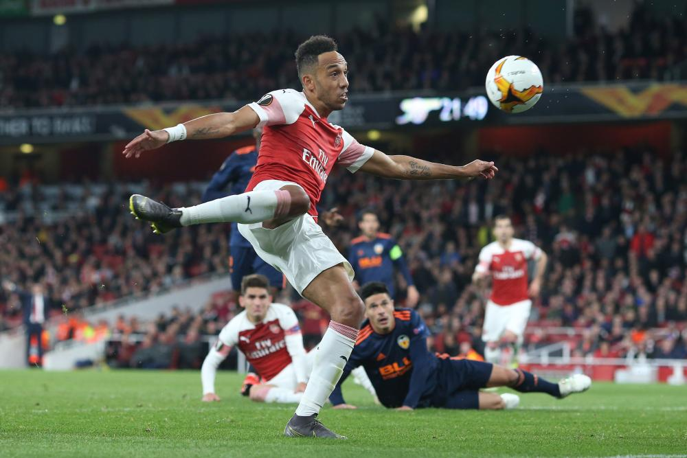 Pierre-Emerick Aubameyang of Arsenal thumps in their third goal.