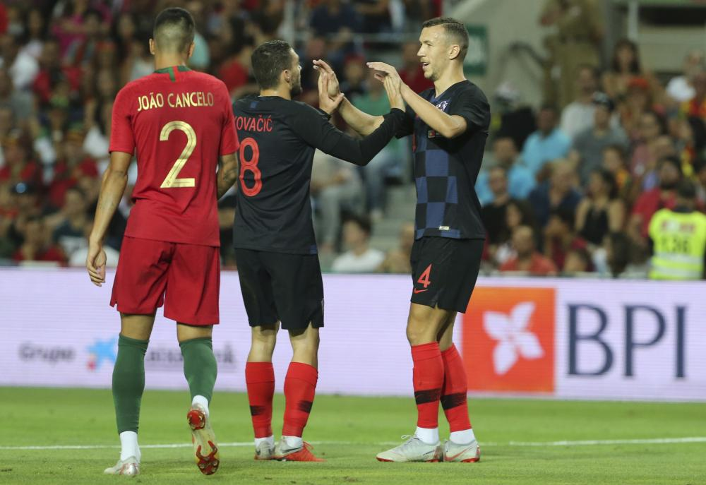 Croatia's Ivan Perisic, right, celebrates after scoring the opening goal during the friendly against Portugal.