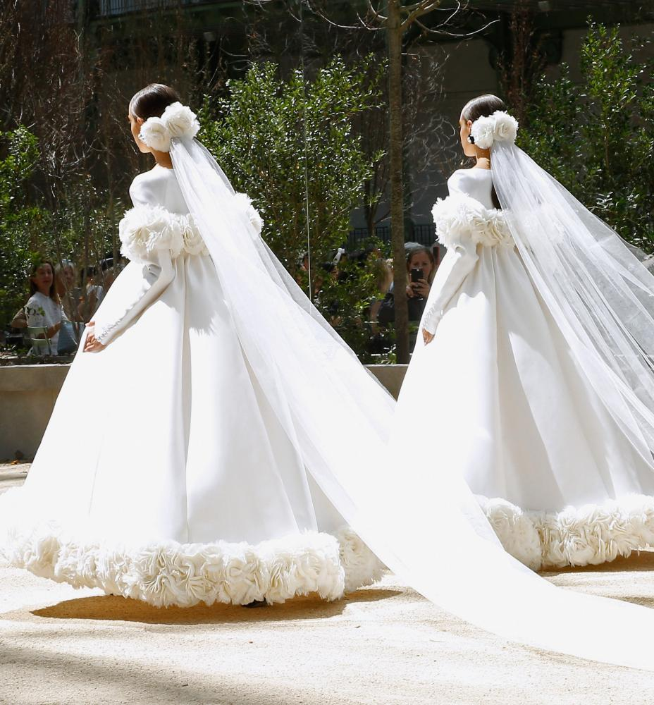 Models presents a creation by German designer Karl Lagerfeld.