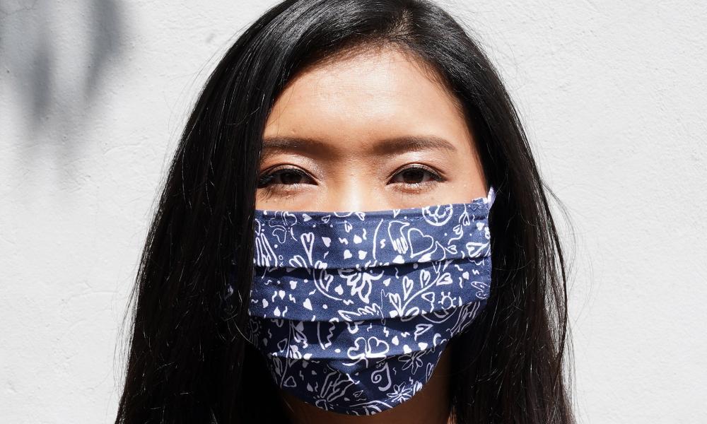 A model wears a mask designed by RIXO.