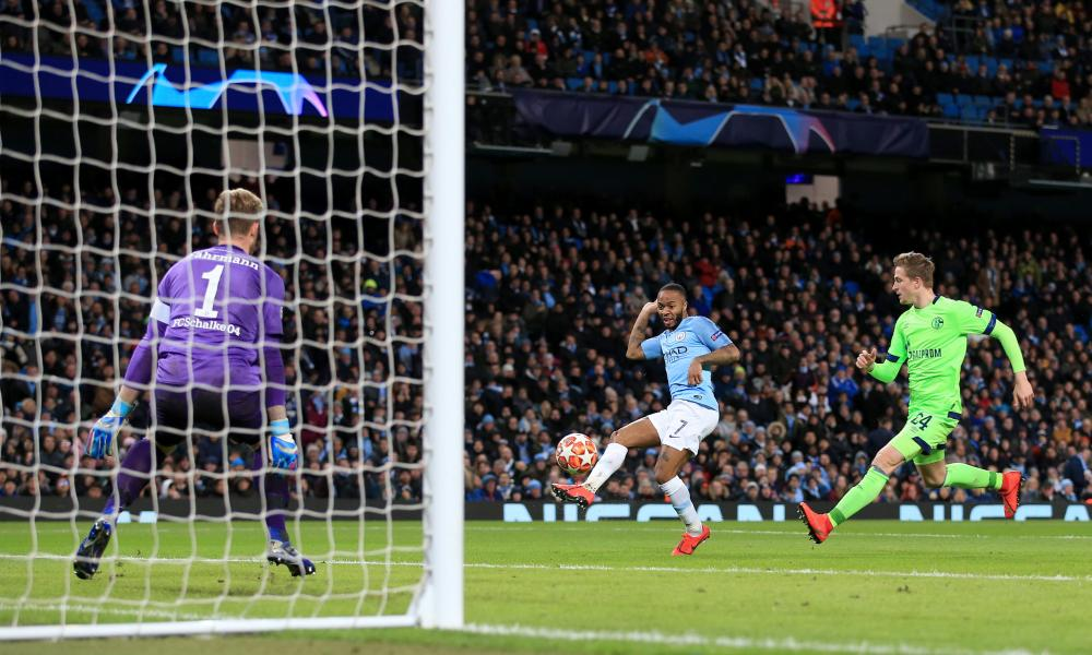 Raheem Sterling of Man City scores their fourth goal.