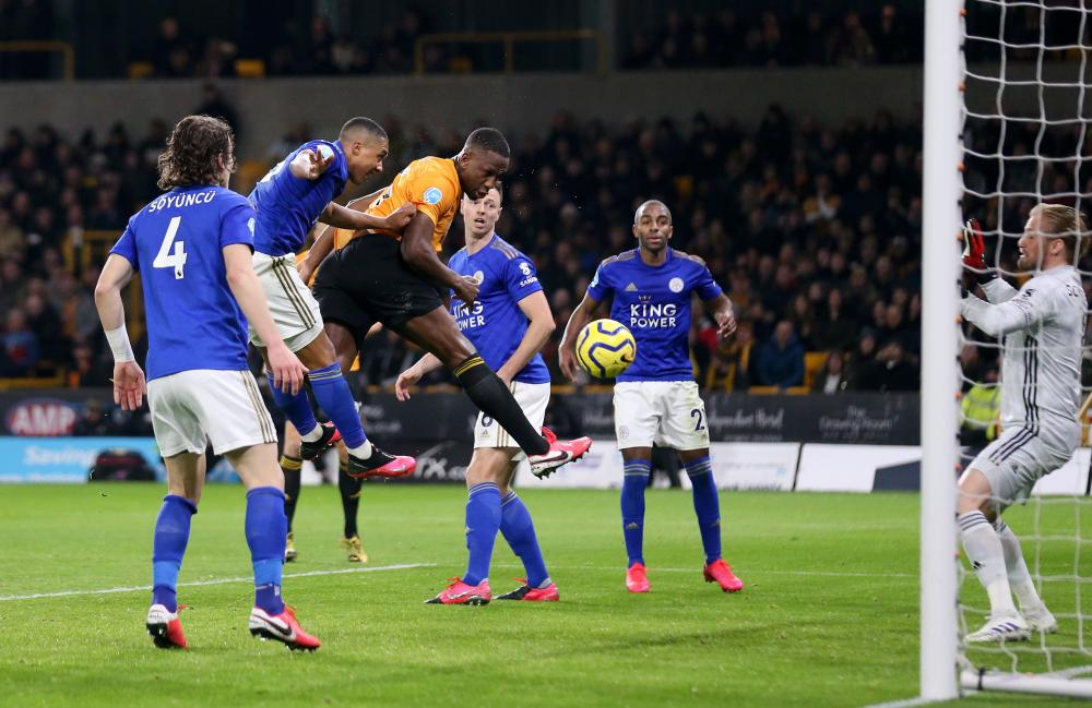 Wolves' Willy Boly scores his sides first goal which is then ruled offside by VAR.