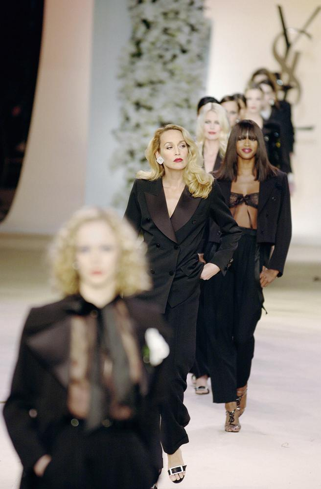 Jerry Hall walks the Yves Saint Laurent haute couture catwalk in 2001
