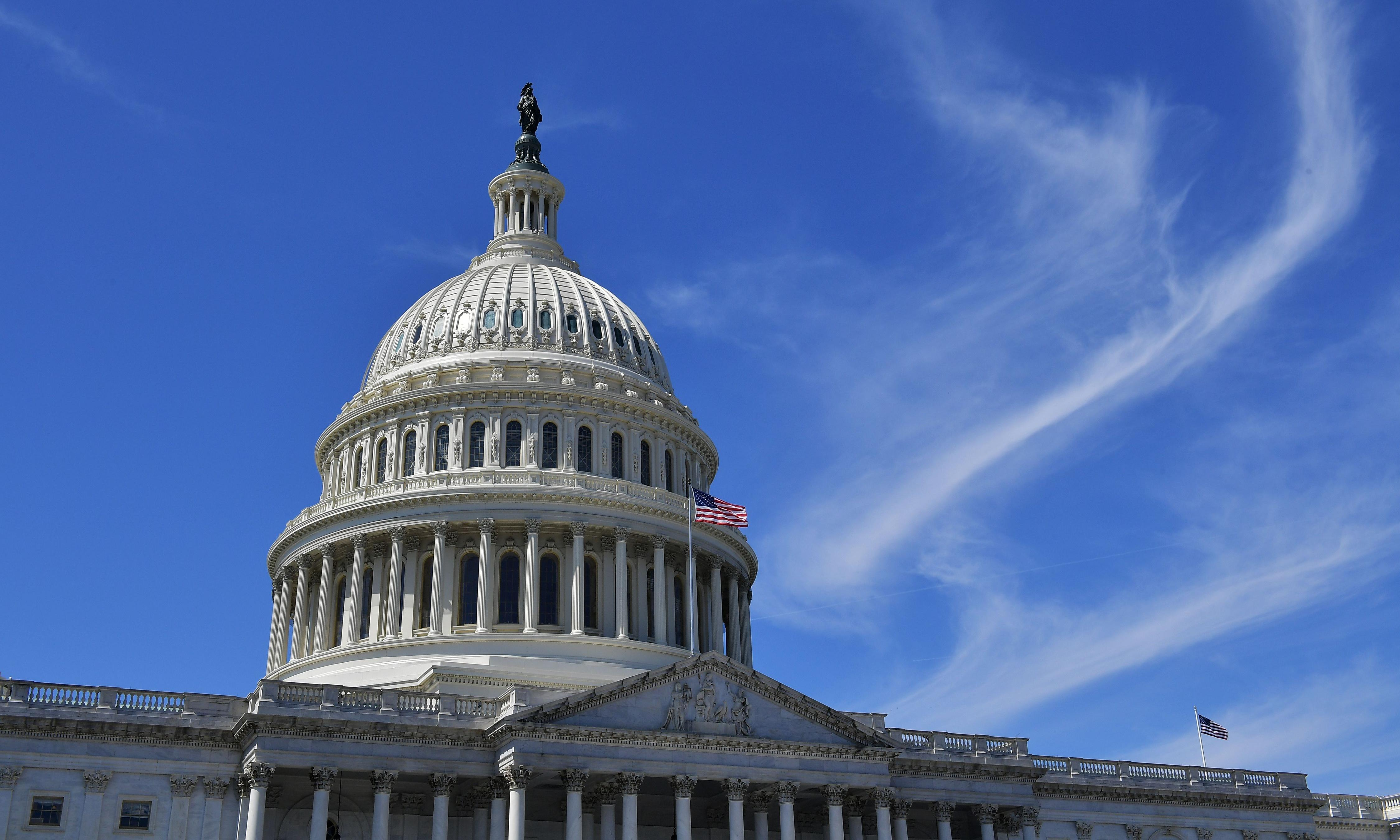 US federal deficit to reach $1tn next year, report says
