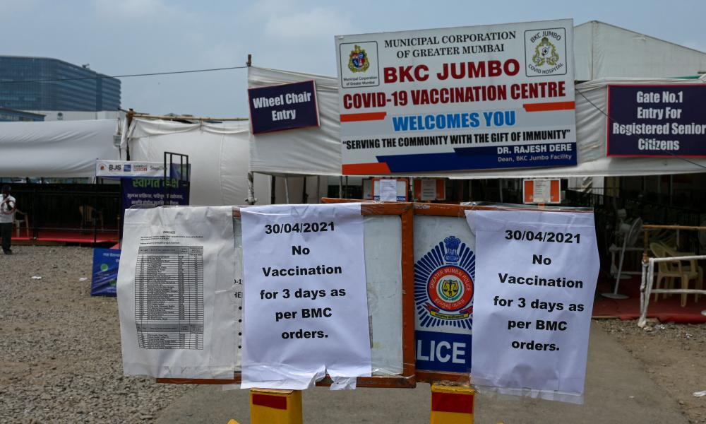 Signs announcing that there will be no vaccination for three days, due to shortage of vaccine supplies, are seen outside a Covid-19 coronavirus vaccination centre, in Mumbai.