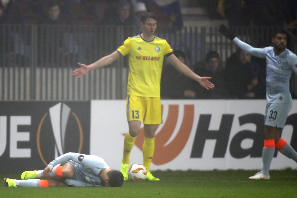 Hazard down after being fouled by Signevich.