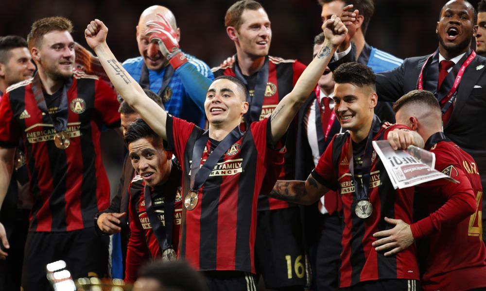 Miguel Almirón lifts his arms to celebrate Atlanta United's MLS Cup triumph.