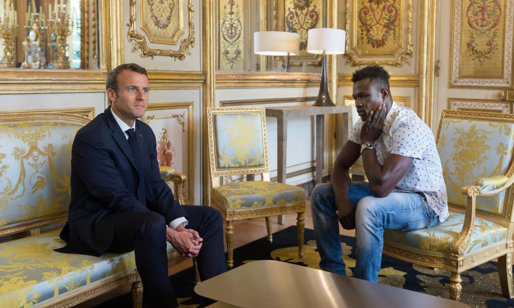 French president Emmanuel Macron meets Mamoudou Gassama at Elysee Palace. Gassama received citizenship after rescuing a toddler hanging from a building.