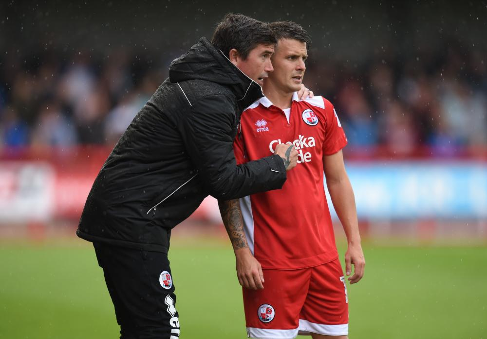 Crawley Town manager Harry Kewell talks to Dean Cox during a pre-season friendly against Brighton.