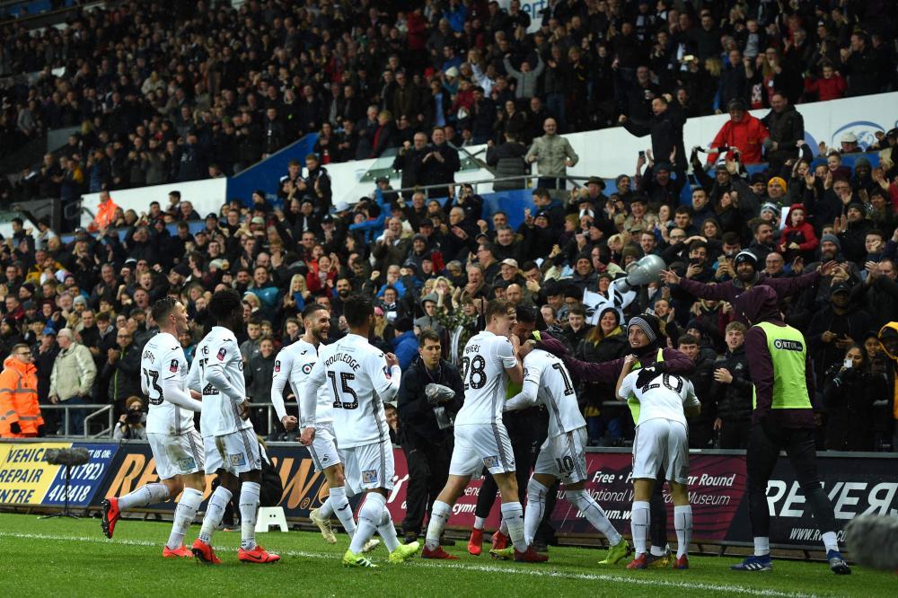 Swansea City's Bersant Celina celebrates after scoring their second goal.