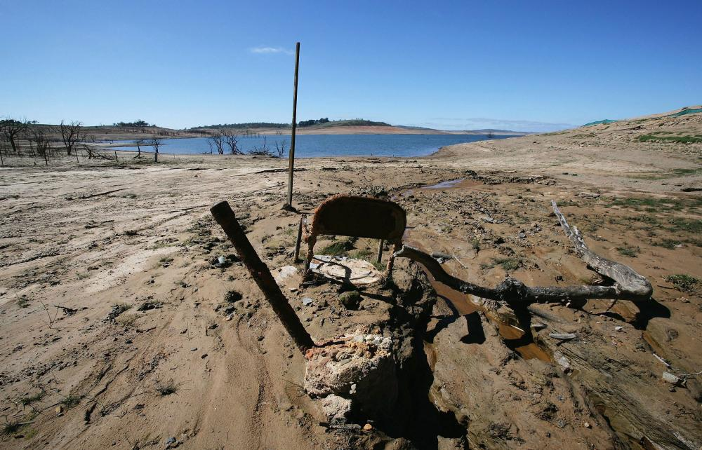 An old chair sticks out of the mud on the shore line of Lake Eucumbene at Old Adaminaby, a town that was flooded as part of the Snowy Mountains Hydro Electric scheme in 1956.