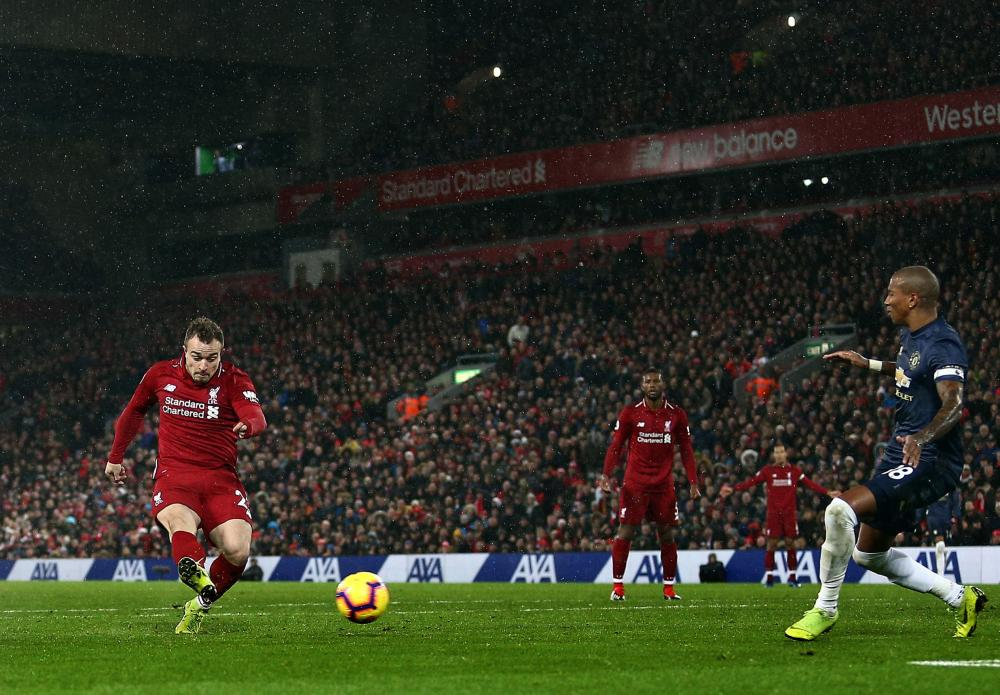 Liverpool's Xherdan Shaqiri scores after coming on as a sub