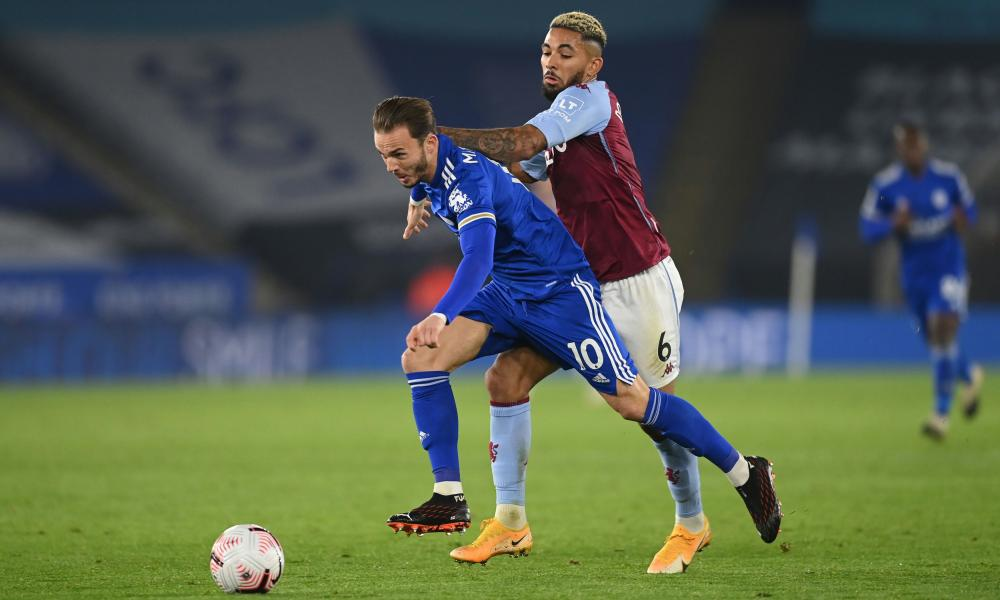 Leicester City's James Maddison in action with Aston Villa's Douglas Luiz.
