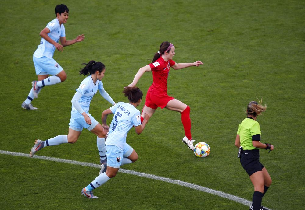 United States' Rose Lavelle surges past the Thailand defence.