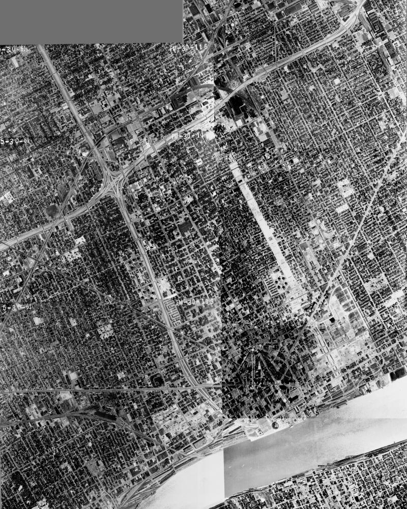 An aerial photomosaic of Detroit, 1961. By this point, the construction of I-94 and Route 10 were complete, with I-75 taking shape. The community of Black Bottom was gutted in the process.