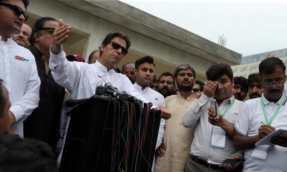 Imran Khan, speaks to members of media after casting his vote at a polling station during the general election in Islamabad