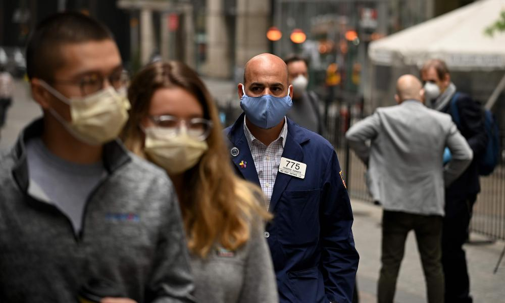 A trader walks in front of the New York Stock Exchange on 26 May 2020 at Wall Street in New York City.