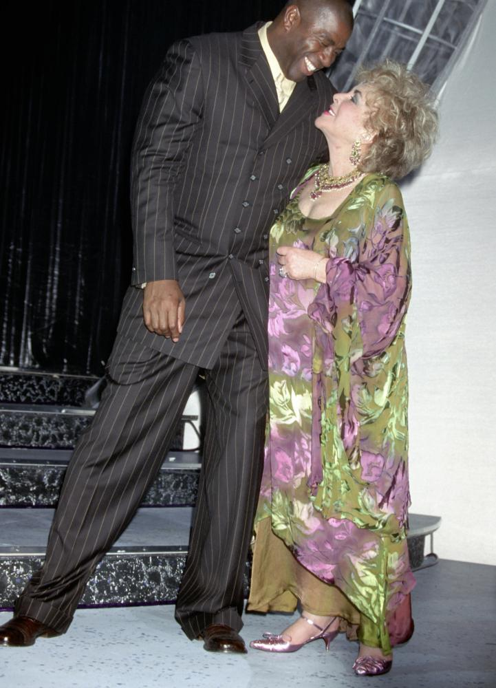Johnson and Elizabeth Taylor at the 20 Years of Aids, 20 Years of Hope event in Santa Monica in 2001.