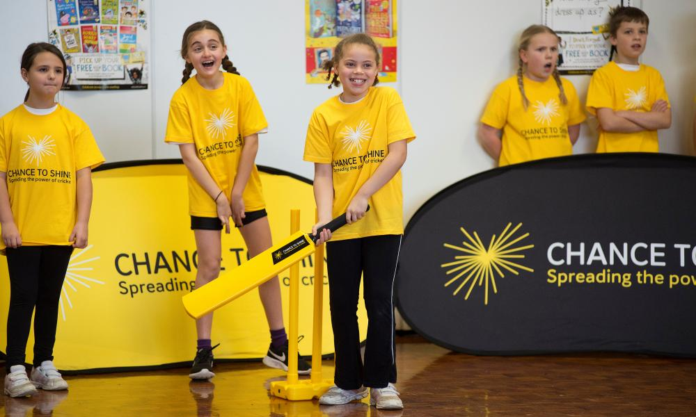 Young children playing indoor cricket