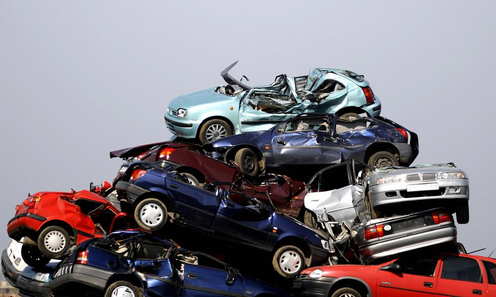 Journey's end: scrapped cars piled up waiting to be dismantled.