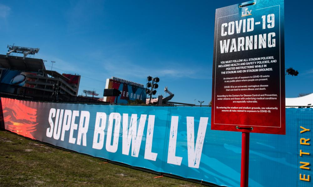 A Covid19 warning sign is seen outside of Raymond James Stadium prior to Super Bowl LV in Tampa, Florida on Thursday, February 4, 2021.