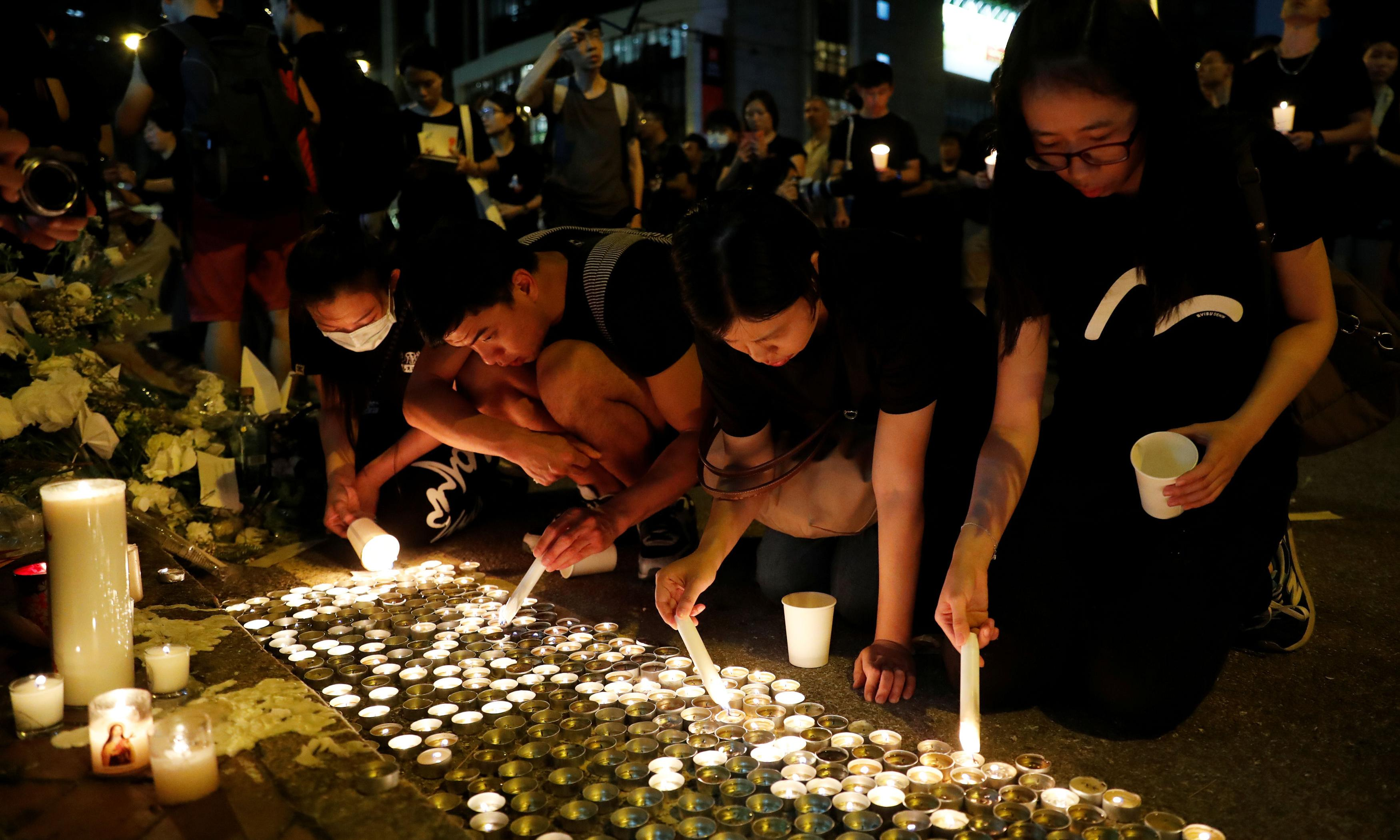 Flowers and tears for 'first martyr' of Hong Kong protests