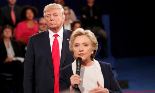 Republican U.S. presidential nominee Donald Trump listens as Democratic nominee Hillary Clinton answers a question from the audience during their presidential town hall debate at Washington University in St. Louis, Missouri, U.S., October 9, 2016. REUTERS/Rick Wilking     TPX IMAGES OF THE DAY