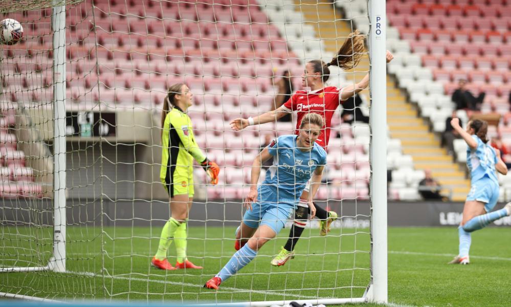 Manchester City's Ellen White celebrates scoring her side's equaliser against Manchester United