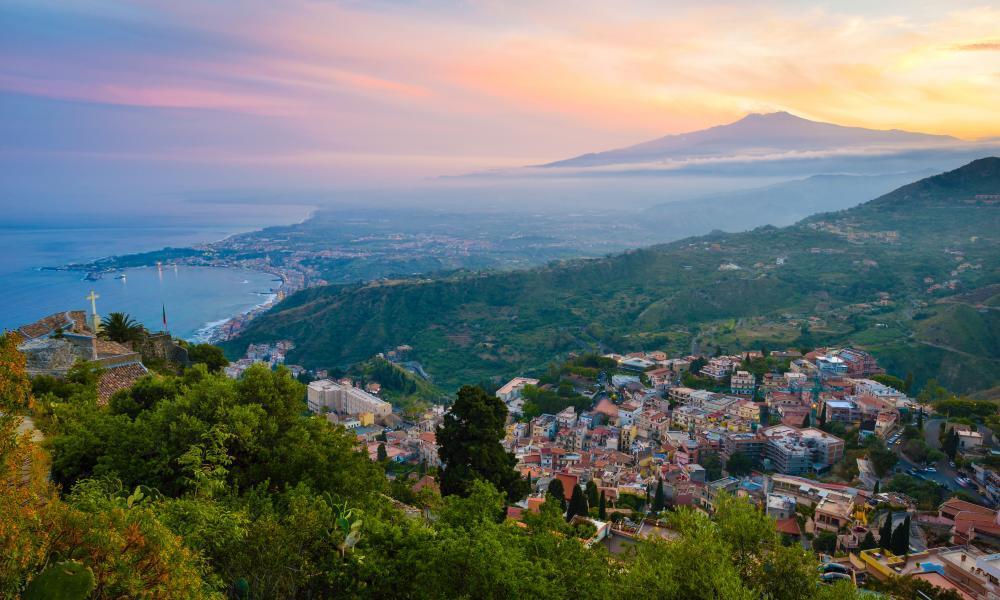 Taormina with Mount Etna at sunset.