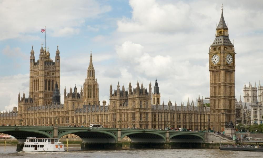 A view of Houses of Parliament and Westminster Bridge from across the River Thames