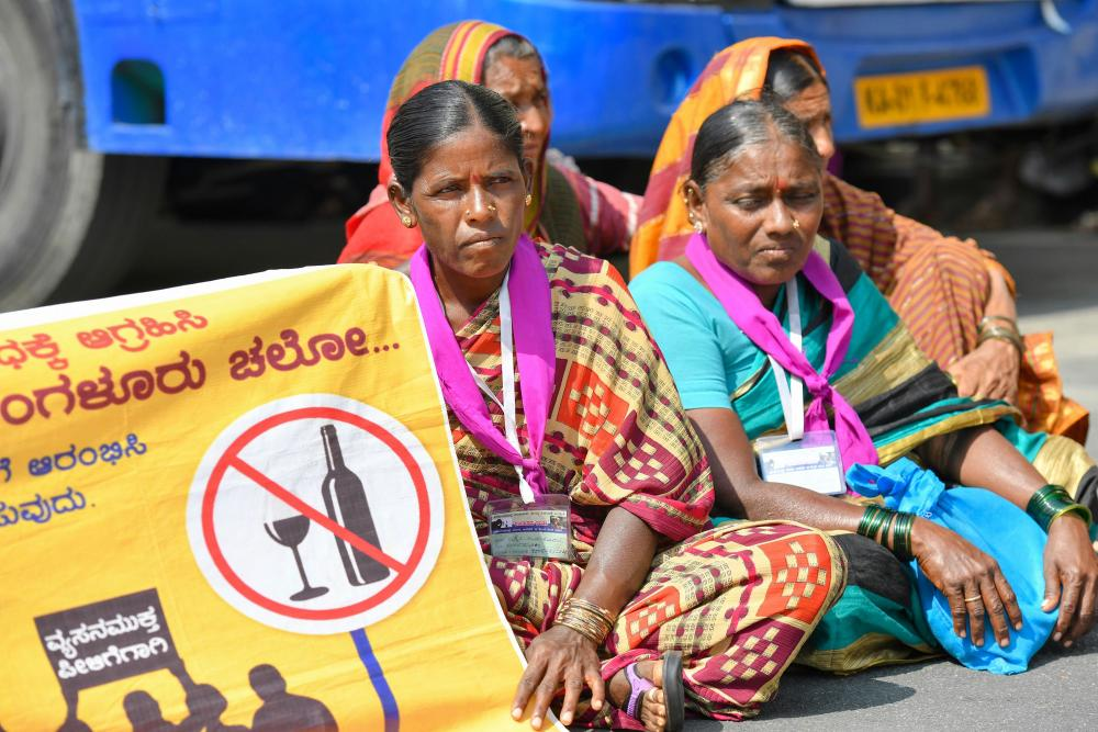 Women in a sit-in protest in the street