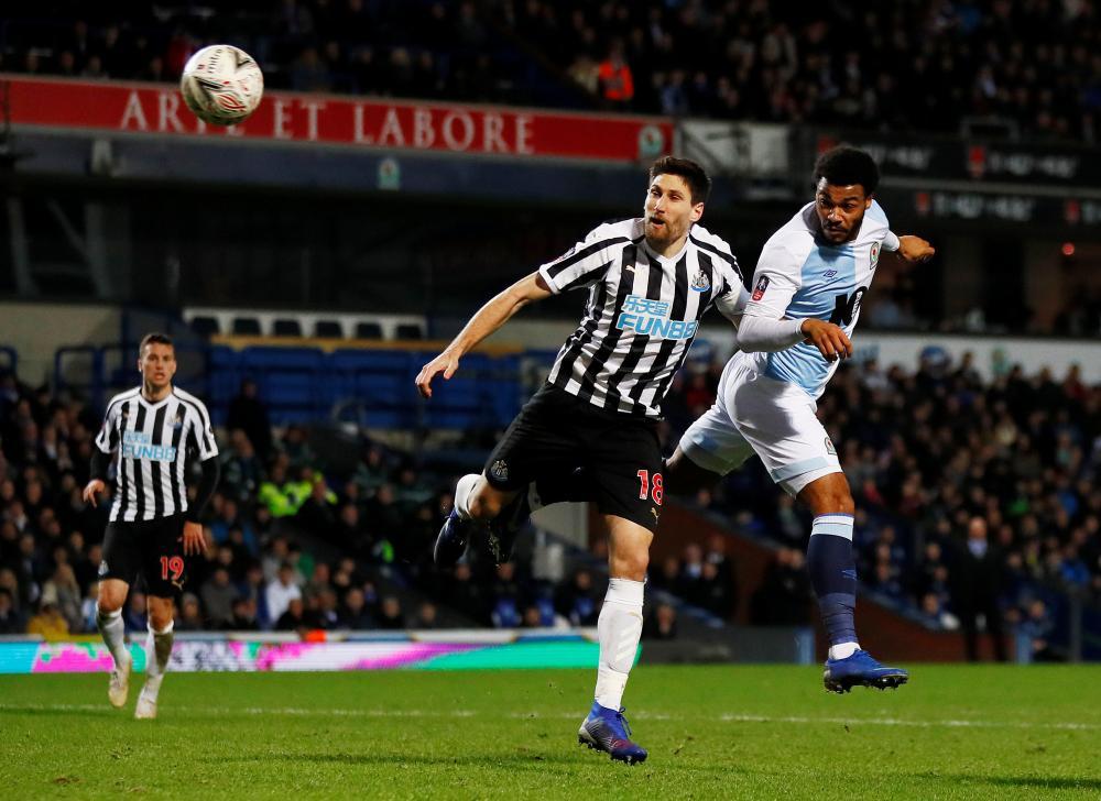 Blackburn Rovers' Joe Nuttall heads wide.