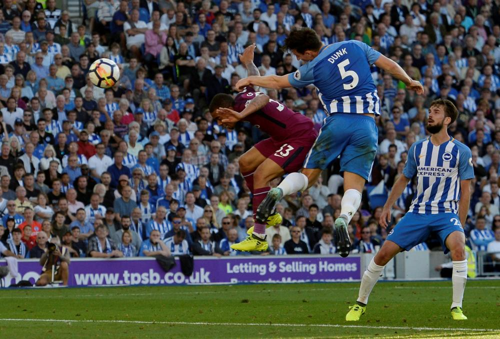Lewis Dunk heads in an own goal.
