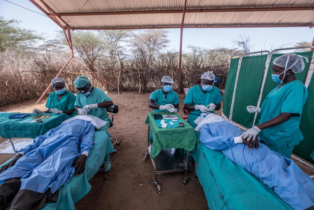 Surgeons perform trachoma operations at a makeshift operating theatre in a remote area of Turkana, Kenya