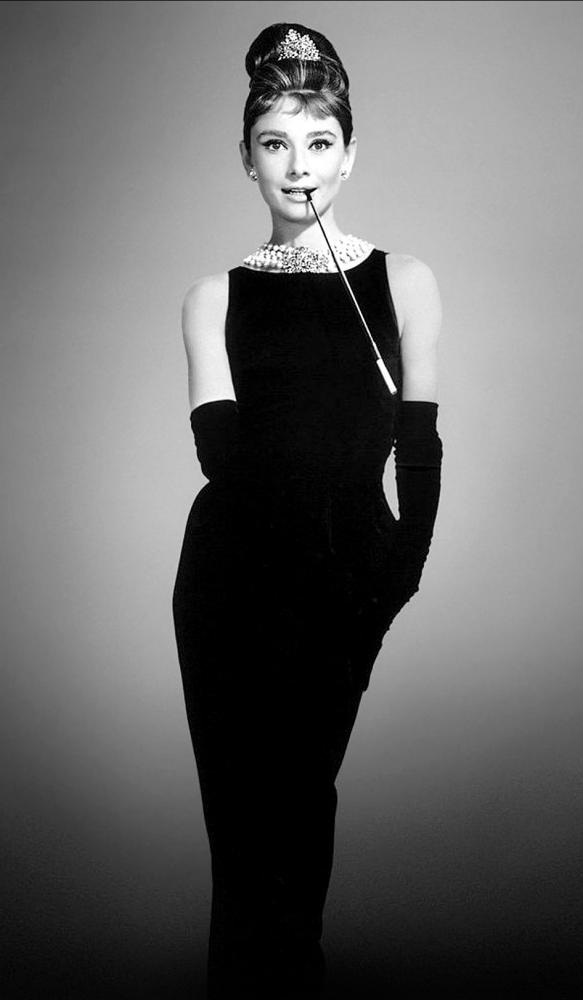 Audrey Hepburn in a black Givenchy shift in the 1961 film Breakfast at Tiffany's.