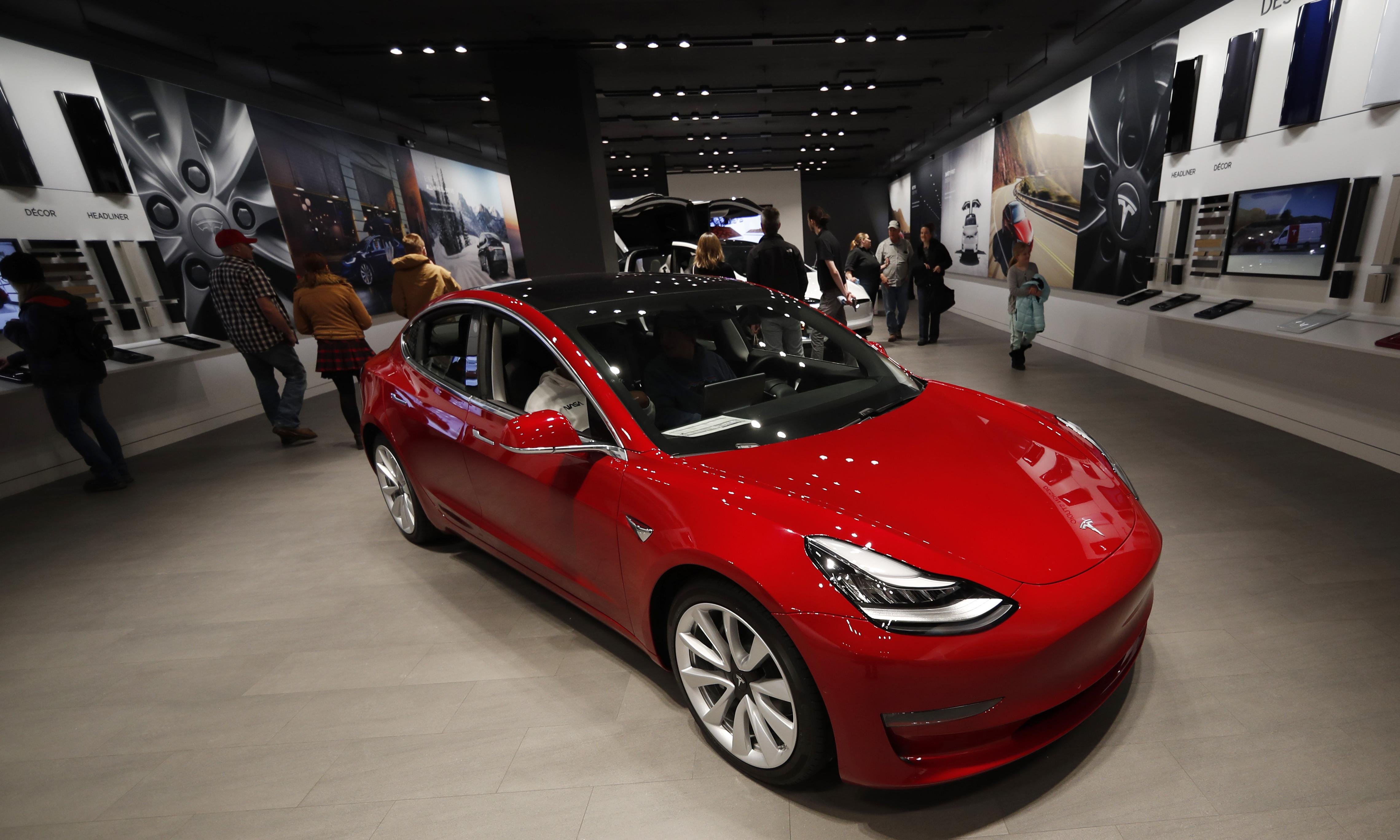 Tesla cuts car prices, shuts stores and shifts to online-only sales